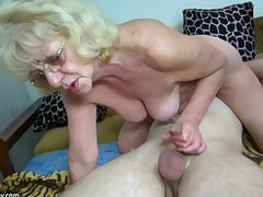 HOT Young guy shagging granny with strap-on
