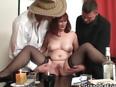 Old bitch fro stockings takes two rods