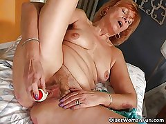 Redheaded granny Susan fucks their way prudish pussy with a dildo