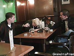 Busty granny is picked upon and fucked by a four horny guys