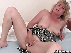 Granny adjacent to heat finger fucks the brush old pussy