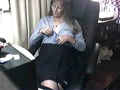 Ill-treat cute granny having fun at computer. Amateur