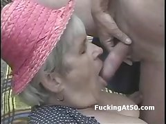 Old granny sucks dick and is pounded dogyystyle aloft the beach