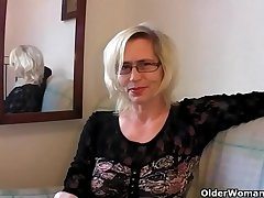 Slutty grandma in stockings fists their way hairy cunt