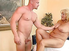 Busty and chunky granny fucked by a bald guy.