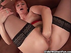 Sleazy grandma in the matter of nylons fist fucks her hairy cunt