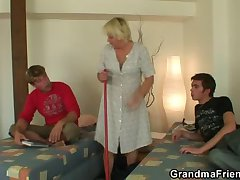 Ancient cleaning woman is banged by two lads