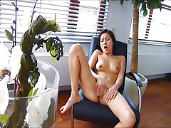 Asian woman orgasms with her chair