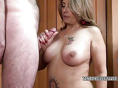 Mature swinger Sandie Marquez is swallowing a simulated cock