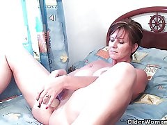 Well-dressed grandma pushes dildo up her ass