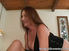 Crestfallen brunette MILF blows stiff cock