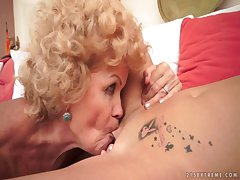 Superannuated coupled with young lesbians having fun