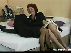Superannuated lesbians zigzagging suits stockings with an increment of heels on to on
