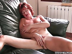 Mature redheaded mom masturbates overhead the couch