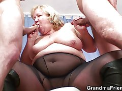 Unselfish titted grandma swallows two cocks
