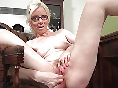 mature blonde solo masturbation on a dresser
