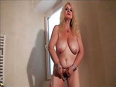 Granny Dana (66) strips coupled with masturbates