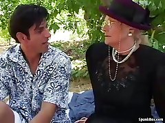 Granny fucks and squirts outdoor