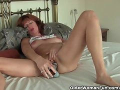 Mature redheaded mom masturbates around dildo