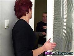 Redheaded slut milf fucks