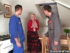 A handful of repairmen bang busty grandma from both ends