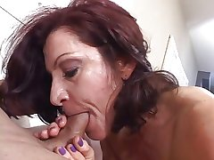 Hot mature brunette capably sucks cock while smoking a cigarette