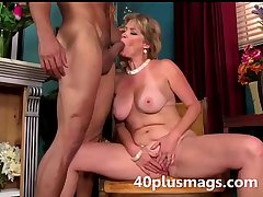 blonde mature beauty preparing to play