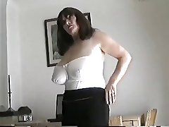 Adult milf with broad tits rubbing her pussy