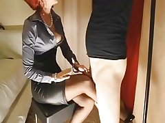 Mature redhead gives her concomitant slattern a footjob