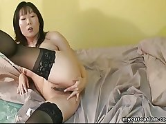 Asian of age main in lust fingers her wet pussy
