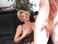 Indelicate blond mature abysm throats a long hard white cock