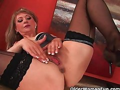 Sultry mature lady stretches will not hear of wanton pussy and squirts