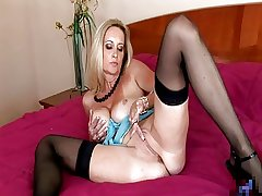 XXX mature masturbates on bed