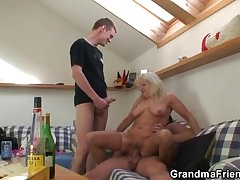 Alchy grandma sucks and rides twosome cocks