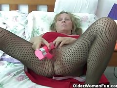 Granny on every side beamy tits wears pantyhose as she fucks a dildo