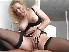 Meticulous flaxen-haired granny in stockings fucks a younger man