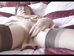 Hairy granny in slip and stockings with respect to see thru panties strips