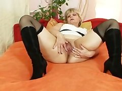 Old grandma moans with might when masturbates