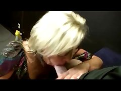 Aurous milf gives head encircling young guy as A he sits back